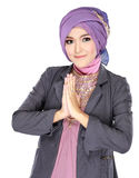 Beautiful welcoming girl wearing hijab smiling Royalty Free Stock Image