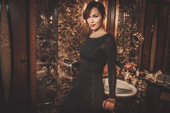 Beautiful well-dressed woman in Luxury bathroom interior. stock image