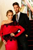 Beautiful well-dressed young couple stock images