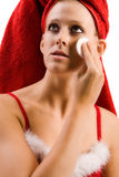 Beautiful wellness girl cleansing her face Royalty Free Stock Image