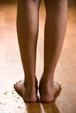 Beautiful and wet female legs on wooden floor Royalty Free Stock Images