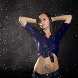Beautiful wet girl with tattoo under rain Stock Photo