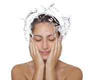 Beautiful wet woman face with water drop stock images