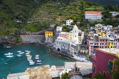 Beautiful wharf in old Italian village Vernazza Chinque Terre with bright colorful houses and boats.  royalty free stock photos