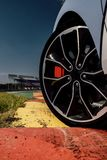 The beautiful wheel of a sport car, with the asphalt, in a race track. sport car on track stock photography