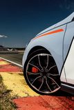 The beautiful wheel of a sport car, with the asphalt, in a race track. sport car on track stock photos