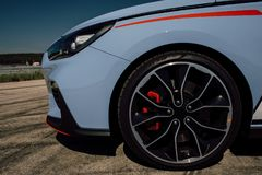 The beautiful wheel of a sport car, with the asphalt, in a race track. sport car on track stock photo