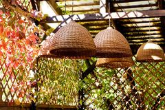 Beautiful whicker lamp shade, colorful autumn still life scene.  Royalty Free Stock Image
