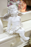 Beautiful white angel. Porcelain figurine Stock Photo