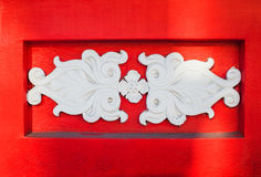 Beautiful white architectural relief pattern on red background Royalty Free Stock Photos