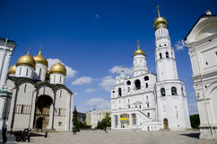 The beautiful white architecture of Ivan the Great bell tower and Orthodox Cathedral Uspenskiy, Moscow Kremlin, Russia Stock Images