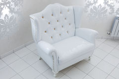Beautiful white armchair Stock Images