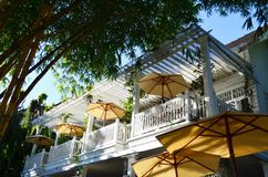 Free Beautiful White Balcony Of Restaurant With Yellow Outdoor Umbrella And Bamboo Under Sun Light, Architecture Concept Royalty Free Stock Photo - 114224965