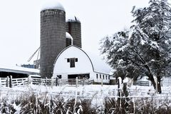 White Barn in Winter with Silos royalty free stock image