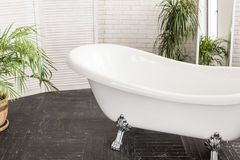 Beautiful white bath in a bright bathroom stock photography