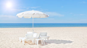 Beautiful White Beach Umbrella And Sun Bed On The Beach. Royalty Free Stock Photography
