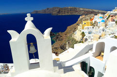 Beautiful white belltower church at Oia, Santorini - Thira, Cycl Stock Image