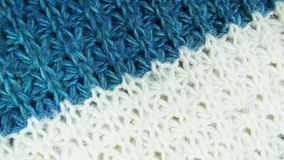 Knitted background. Beautiful white and blue knitted background Royalty Free Stock Photo