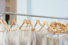 Beautiful white bridesmaid dresses hanging on trempel Stock Photos