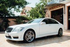 Beautiful white car parked near house Royalty Free Stock Photos
