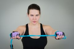 beautiful white caucasian girl in a black T-shirt on fitness holding a jump rope royalty free stock photography