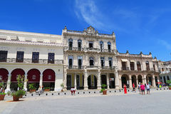 A beautiful white central square in Havana. Cuba, Havana - 07 April, 2016: one of the central squares of Havana with vintage colorful buildings on a bright sunny Royalty Free Stock Images