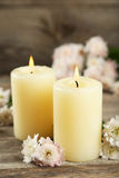 Beautiful white chrysanthemums with candles on wooden background Stock Photos