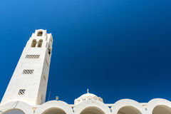 Beautiful White Churcg Of Oia In Santorini, Greece Stock Photo