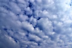 Beautiful white cloud formations in a deep blue sky on a sunny day. Seen in germany stock photo