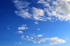 Beautiful white cloud formations in a deep blue sky on a sunny day. Seen in germany royalty free stock photography