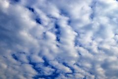 Beautiful white cloud formations in a deep blue sky on a sunny day. Seen in germany stock photography
