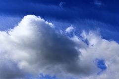 Beautiful white cloud formations in a deep blue sky on a sunny day. Seen in germany royalty free stock photos
