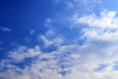 Beautiful white cloud formations in a deep blue sky on a sunny day. Seen in germany royalty free stock image