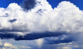 Beautiful white cloud formations in a deep blue sky on a sunny day. Seen in germany royalty free stock images