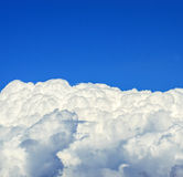 Beautiful white clouds beneath blue sky background Stock Photos