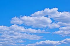 Beautiful white clouds in the blue sky. Scenic view royalty free stock image