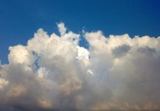A beautiful white clouds in a blue sky. A closeup shot of a beautiful, fluffy white clouds in a blue sky royalty free stock images