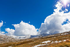 Beautiful white clouds and blue sky over Snowy Mountains, New So Royalty Free Stock Image