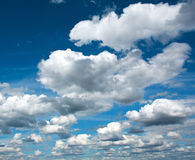 Beautiful white clouds in the clear blue sky, purity of nature. Beautiful white clouds in the clear blue sky, the purity of nature Stock Photos