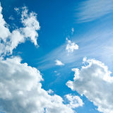 Beautiful white clouds in the clear blue sky, purity of nature Royalty Free Stock Image