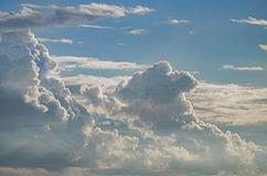 Beautiful white clouds on evenings sky. Evening Happiness Idyllic Wallpaper Royalty Free Stock Photography