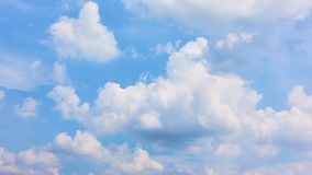 Beautiful white clouds moving across summer blue sky stock footage