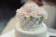 Beautiful white and colored wedding cake Stock Photography