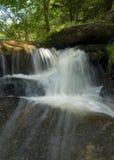 Beautiful white creek with stones Stock Photos