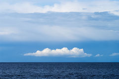 Beautiful white cumulus and altostratus cloud formation over the Baltic sea. Royalty Free Stock Photos