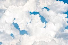 Beautiful white curly fleecy clouds on blue sky background. Vibrant multicolored outdoors horizontal image with copy space Royalty Free Stock Image