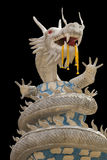 Beautiful white dragon statue on black background Stock Image