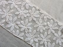 Beautiful white fabric with flowers. Nice white fabric with beautiful flowers, can use as background Stock Photo