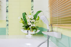 Beautiful white faucet on bathtube Stock Images