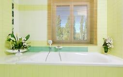 Beautiful white faucet on bathtube near window Royalty Free Stock Photos